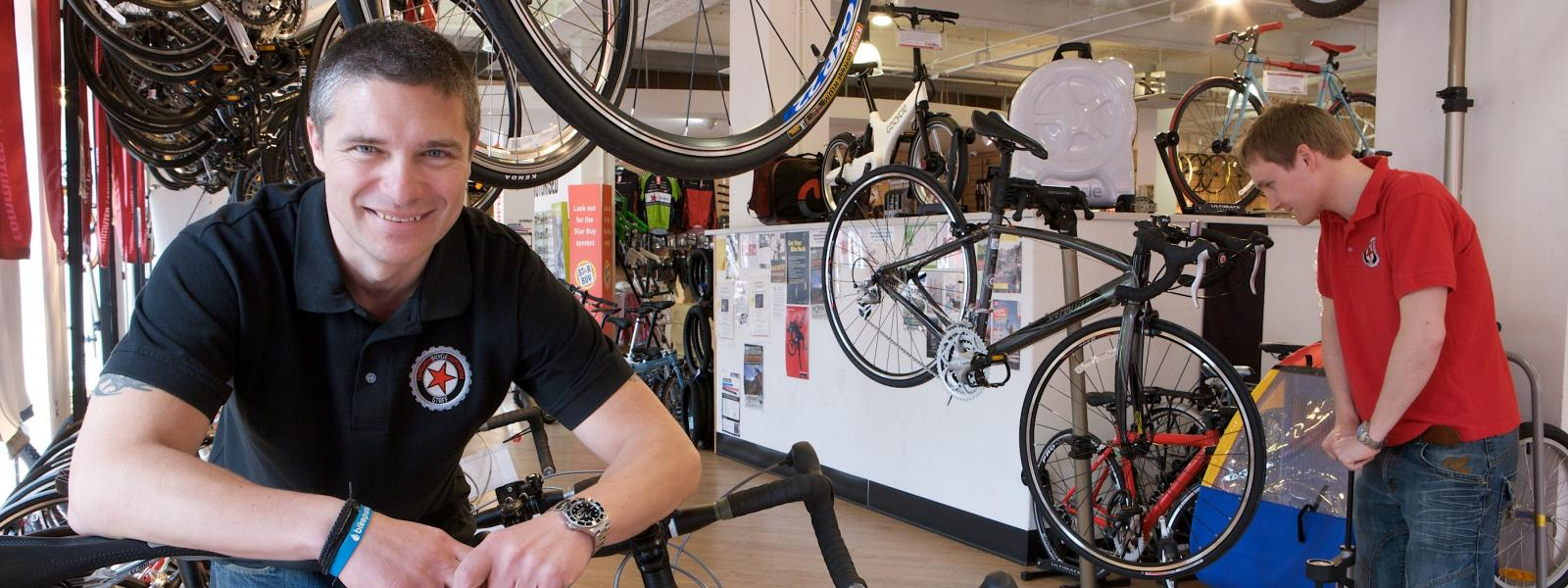 Member of Edinburgh Bicycle Co-op with bikes