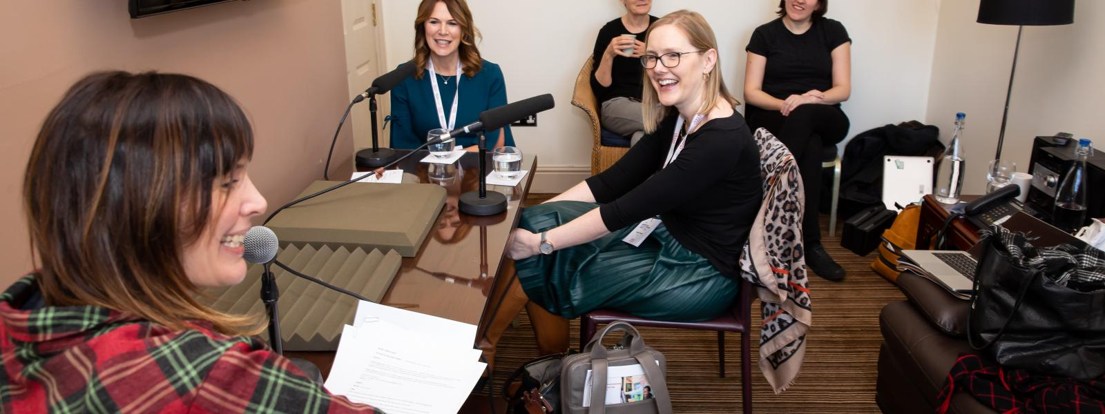 Two women being interviewed for podcast