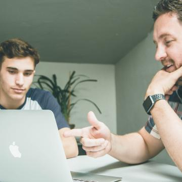Man giving advice to younger man