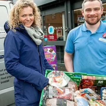 Co-op worker donating food