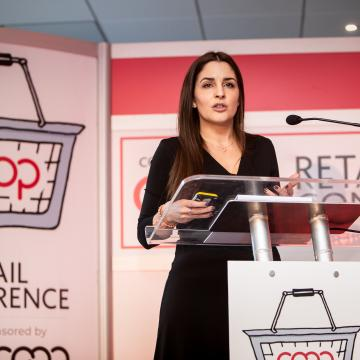 Woman speaking at the co-op retail conference