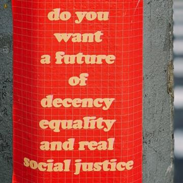 Sign saying do you want a future of decency equality and real social justice