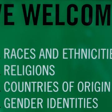 Sign  saying we welcome all races and ethnicities